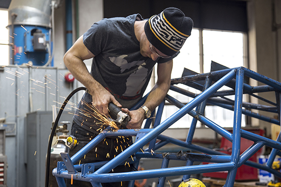 A Detroit Mercy student uses a welder on a project.